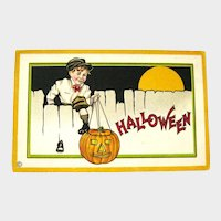 Vintage Unused Stecher Halloween Postcard - Boy Climbing Fence - Jack-o-lantern - Full Moon