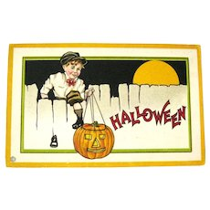Vintage Unused Stecher Halloween Postcard - Boy Climbing Fence - Jack-o-lantern - Full Moon
