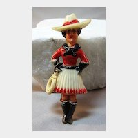 Early Plastic Cowgirl Holding Lasso Pin