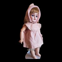 Adorable French small pretty doll Cabinet size 1 with Trousseau.