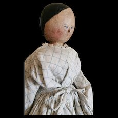 Touching Early German wooden Doll in original condition.