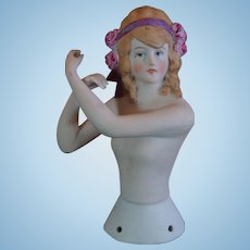 Beautiful German Half doll with a Flowery Haircut.