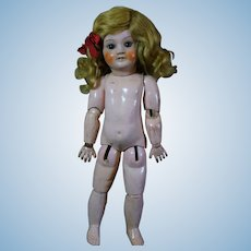 Jumeau body Size 6 with a beautiful original mohair wig.