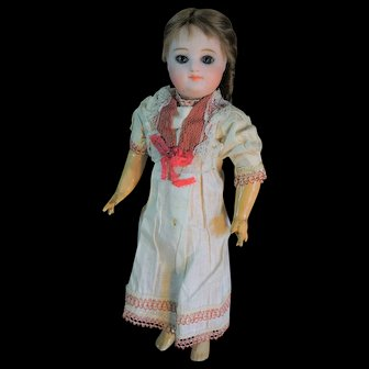 "(10"" 5\8) Pretty Interesting cabinet size doll by Henri Delcroix"