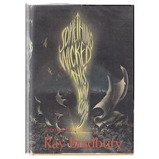 Something Wicked This Way Comes by Ray Bradbury.  First edition (1962) in unclipped jacket.  Signed on bookplate by Bradbury.