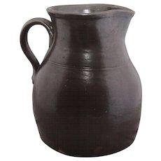 Antique redware batter pitcher