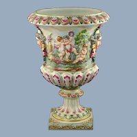 Large Antique Capodimonte Hand Painted Bolted Urn with Putti and Mask Head Motif