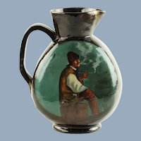 Antique 19th Century Emilé Galle Nancy Hand Painted Earthenware Pitcher Featuring a Man Smoking
