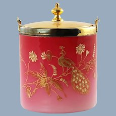 Antique Peachblow Lidded Biscuit Barrel with Gilt Enamel Decoration Featuring a Peacock and Stylized Flowers
