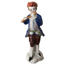 Young Gent Playing Flute Figurine