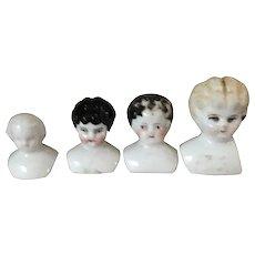 Set of 4 Tiny China Doll Heads