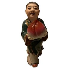 Vintage Chinese Export Famille Rose Stand Figure Porcelain  Of A Boy  Holding A Peach