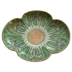 Chinese porcelain plate decorated in cabbage and butterfly motif 19th century