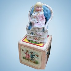 Small French porcelain Trinket Box of a pretty little girl and her dog.