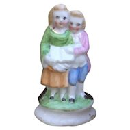 Sweet Miniature Antique French Figurine of Children.