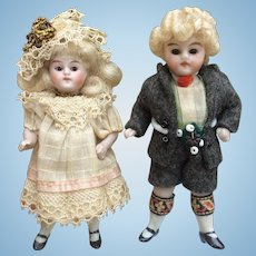 Lovely Pair of Miniature Antique All Bisque Dolls in Original Clothing for Dolls House or Room Setting.