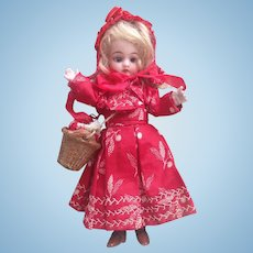 """Adorable and Rare 7"""" All Bisque Mignonette ' Le Petit Chaperon Rouge' ( 'Little Red Riding Hood' ) in her Original Trunk with integral 'Grandmother's bed. Charming!"""