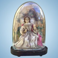 Early Wax Doll, All Original, under Original Glass Dome.