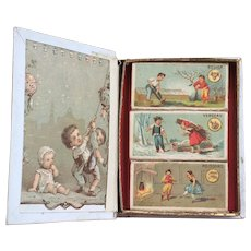 Lovely Set of Tiny Antique French Candy Boxes or Needle Boxes with pretty lithographed lids in their Original Book shaped box.  Perfect for display with your French Bebe or Fashion Poupee.
