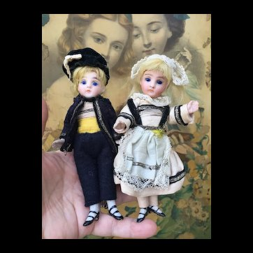 """Pair of All Bisque Mignonettes in Original Clothing. 5.25"""""""