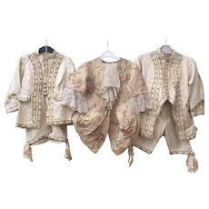 Three Charming Early antique 19th Century French Childrens costumes in early 18th Century style.