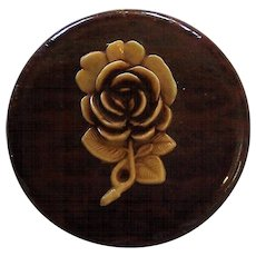 Celluloid flower on wood background brooch