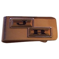 """vintage gold tone money clip with initials """"J' and """"H""""."""