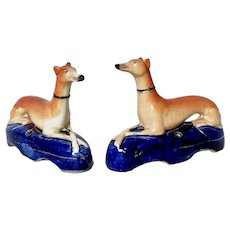 Pair of Staffordshire pottery greyhound/whippet pen holders, early 19th C