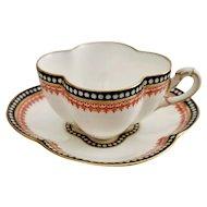 Coalport teacup and saucer, quatrefoil black and red, 1875-1881