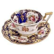 Coalport teacup and saucer, cobalt blue, gilt and flowers, ca 1825
