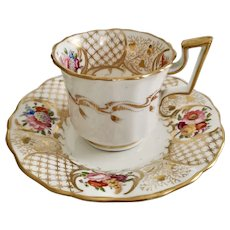 Davenport coffee cup and saucer, gilt and hand painted flowers, ca 1825