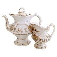 Teapot and milk jug attr. to Rockingham, Rococo Revival , ca 1840