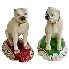 Two Rockingham pug dogs on Rococo base, ca 1835