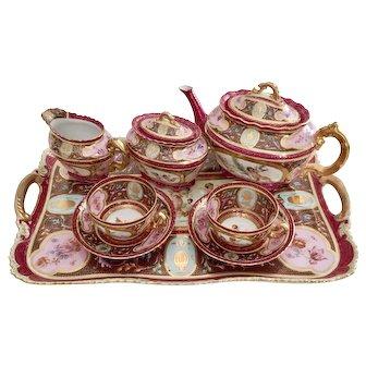 "Romantic Vienna-style ""tête à tête"" cabaret tea set, pink, maroon and cherubs, 1890s"