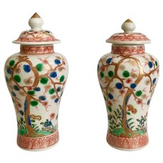 Pair of small Japanese Imari vases with Prunus trees, Meiji period 19th C