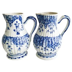 Two KangXi jugs, ribbed blue and white, 1700-1730