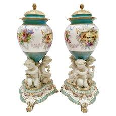 Pair of Copeland potpourri vases, base with parian putti squeezing grapes, 1891