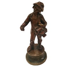 Antique Bronze Sculpture Of A Young Boy Selling Kitchen Wares