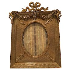 Antique Bronze Frame With Great Details and Curved Glass