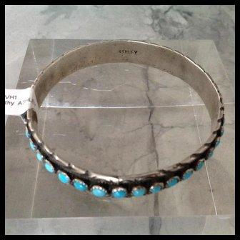 Round Native American SNAKE EYES Bangle bracelet with turquoise rounds all around signed ASHLEY