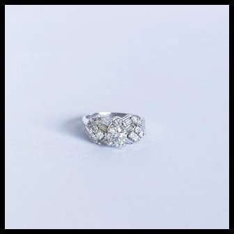 Amazing and different custom style from the 1940's with a stunning old clean and bright .80 point diamond center
