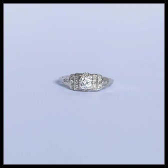 Single band diamond ring with quite the Art Deco Style and from the period, .50 clean bright center diamond
