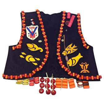 Old Campfire Girls Vest covered in badges and wooden Honor Beads from 1938