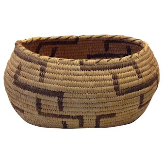 "Old Navajo basket, resembles ""Whirling Logs"" pattern"