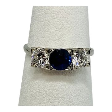 Victorian 3 stone ring (Trilogy) 1 carat Round Brilliant ( 2-.50c each side) and .80c sapphire