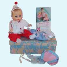1950'S VOGUE Ginnette Baby Doll & Box; Working Squeaker, Her First Outfit, Snowsuit, Booklet, and more....