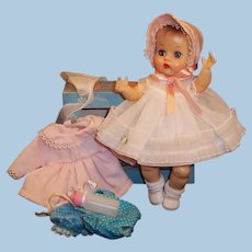 1950'S VOGUE Ginnette Baby Doll:  Party Dress, Coat, Bonnets, Romper, Box, Shoes, Socks, and more...