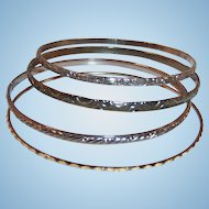 (Four) Thin Mixed Metal Embossed Bangle Bracelets