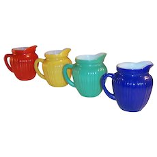 Hazel Atlas  Set of 4 Gay Rainbow Ribbed Milk Pitchers