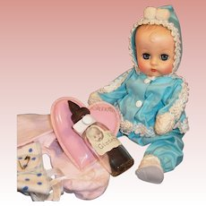 1950's Vogue Ginnette Doll with Snowsuit, Shoes, Socks, Pajamas, Diaper, Glass Bottle and Heart Pillow